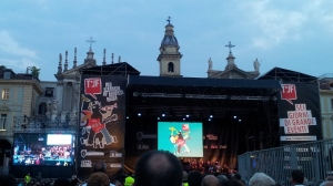 The acoustics in Piazza San Carlo aren't even that good, but the two churches and dramatic summer skies make a good background for the stage.