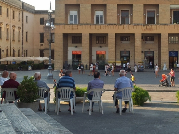 Old men on plastic chairs in Lecce, Puglia