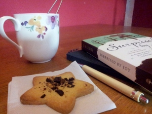 Tea, cookie, book and journal